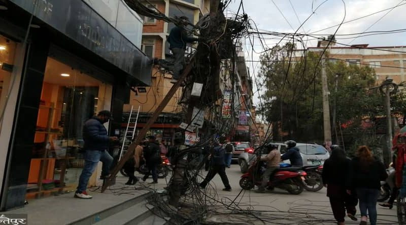 internet disturb in thamel kathmandu as local cuts the hanging wires